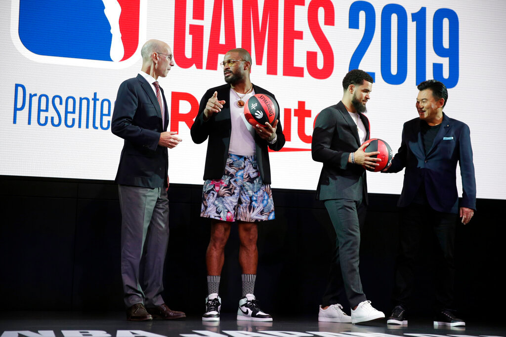 NBA Commissioner Adam Silver, left, talks to Houston Rockets' P. J. Tucker while Toronto Raptors' Fred VanVleet talks to Rakuten, Inc. Chairman & CEO Mickey Mikitani, right, during a welcome reception for the NBA Japan Games 2019 between the Toronto Raptors and the Houston Rockets in Tokyo, Japan, Monday, Oct. 7, 2019. (AP Photo/Kiichiro Sato)..