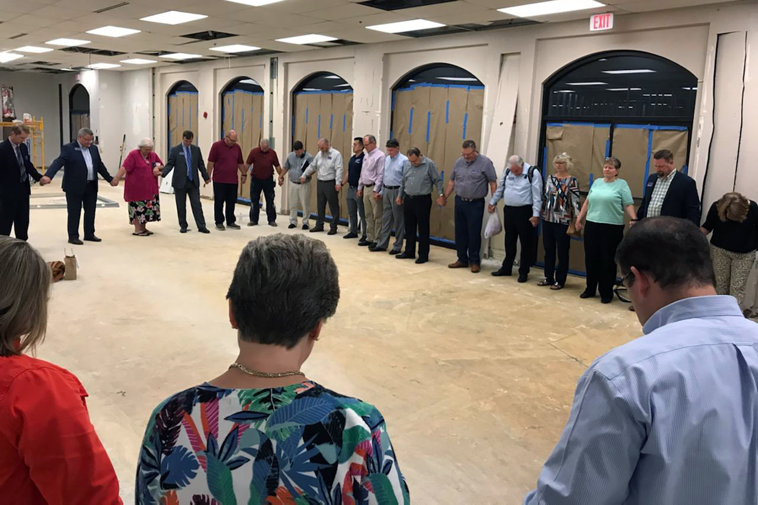 Members of the New Orleans Baptist Theological Seminary and Leavell College board of trustees pray in the space that will house the new Leavell College offices. Renovations to the former location of the LifeWay campus store are well underway. NOBTS leaders expect the Leavell College offices to move to the renovated space in January 2020. (NOBTS photo)