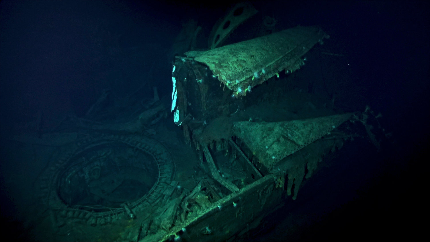 In this Oct. 7, 2019 image taken from underwater video provided by Vulcan Inc., the Japanese aircraft carrier Kaga is shown in the Pacific Ocean off Midway Atoll in the Northwestern Hawaiian Islands. Deep-sea explorers scouring the world's oceans for sunken World War II ships are honing in on a debris field deep in the Pacific. A research vessel called the Petrel is launching underwater robots about halfway between the U.S. and Japan in search of warships from the Battle of Midway. Weeks of grid searches around the Northwestern Hawaiian Islands already have led the Petrel to one sunken battleship, the Kaga. This week, it's investigating what could be another. (Vulcan Inc. via AP)