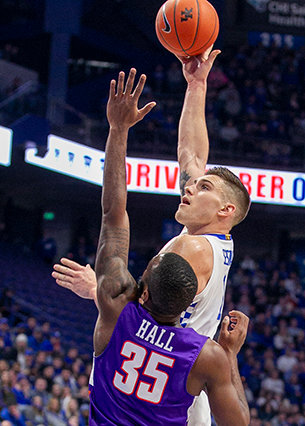 Kentucky's Nate Sestua hooks one toward the basket against Evansville.  (Kentucky Today/Tammie Brown)
