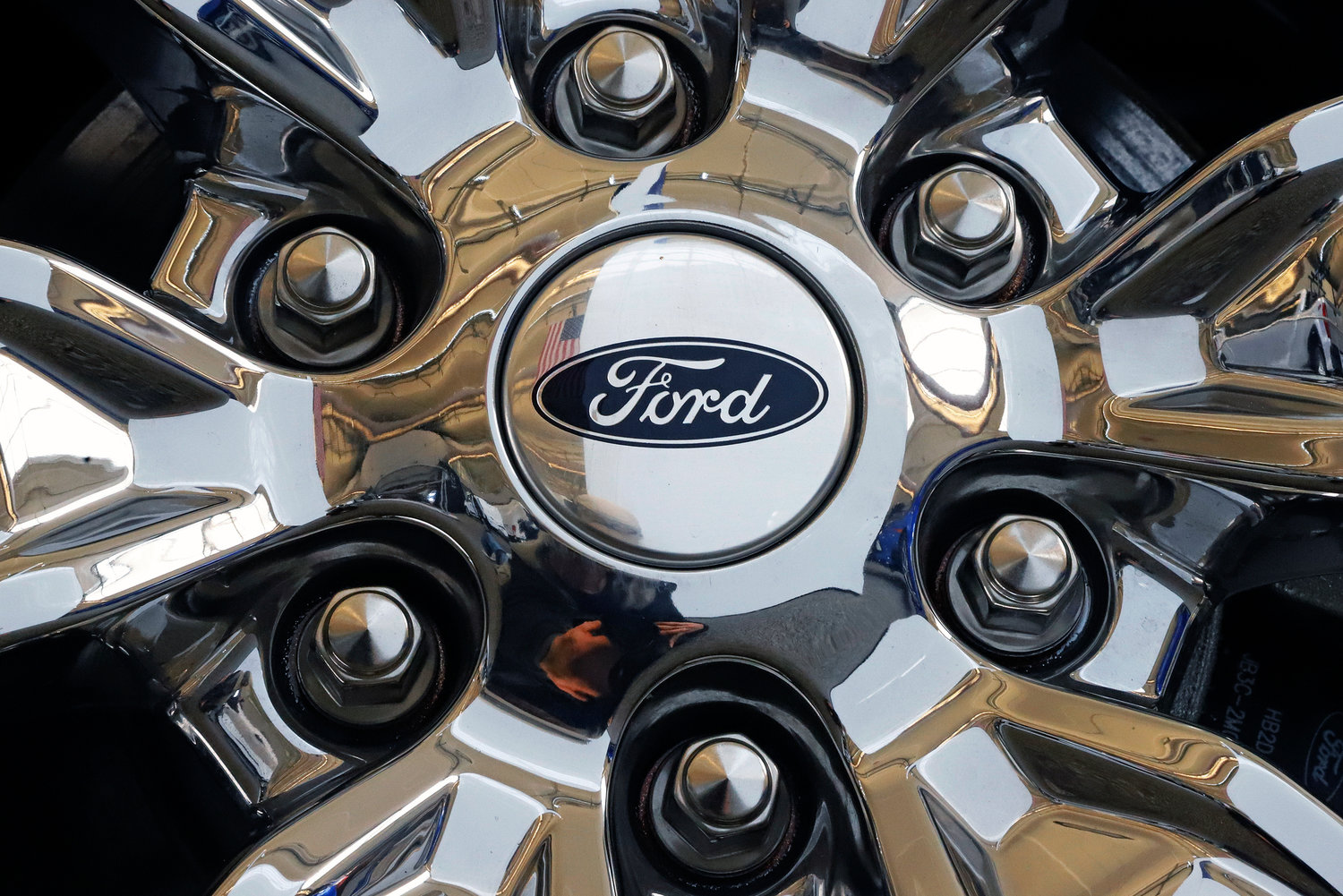 In this Feb. 14, 2019, file photo a wheel on a 2019 Ford Expedition 4x4 is displayed at the 2019 Pittsburgh International Auto Show in Pittsburgh. Members of the United Auto Workers union at Ford Motor Co. have voted to approve a new contract with the company. The union says in a statement Friday, Nov. 15, 2019,  that 56.3% of workers who voted were in favor of the deal. (AP Photo/Gene J. Puskar, File)