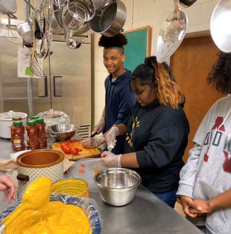 Students from Central Gwinnett High joined in with meal preparation alongside Central Baptist Church members this football season.