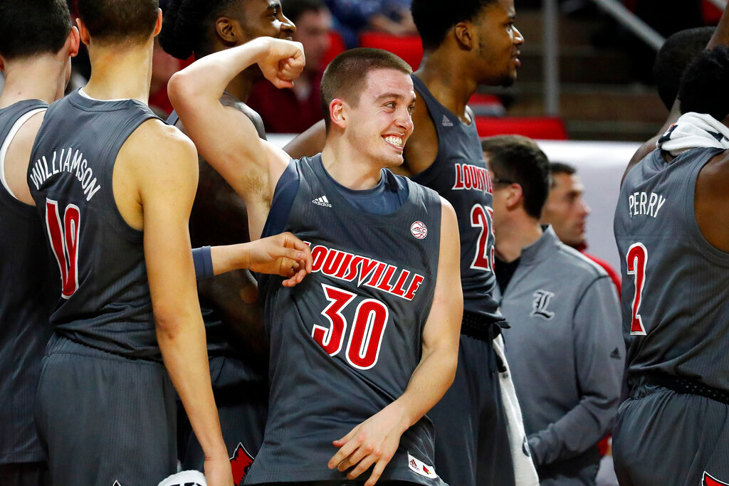 Louisville's Ryan McMahon (30) celebrates during closing minutes of the second half of an NCAA college basketball game against North Carolina State in Raleigh, N.C., Saturday, Feb. 1, 2020. (AP Photo/Karl B DeBlaker)