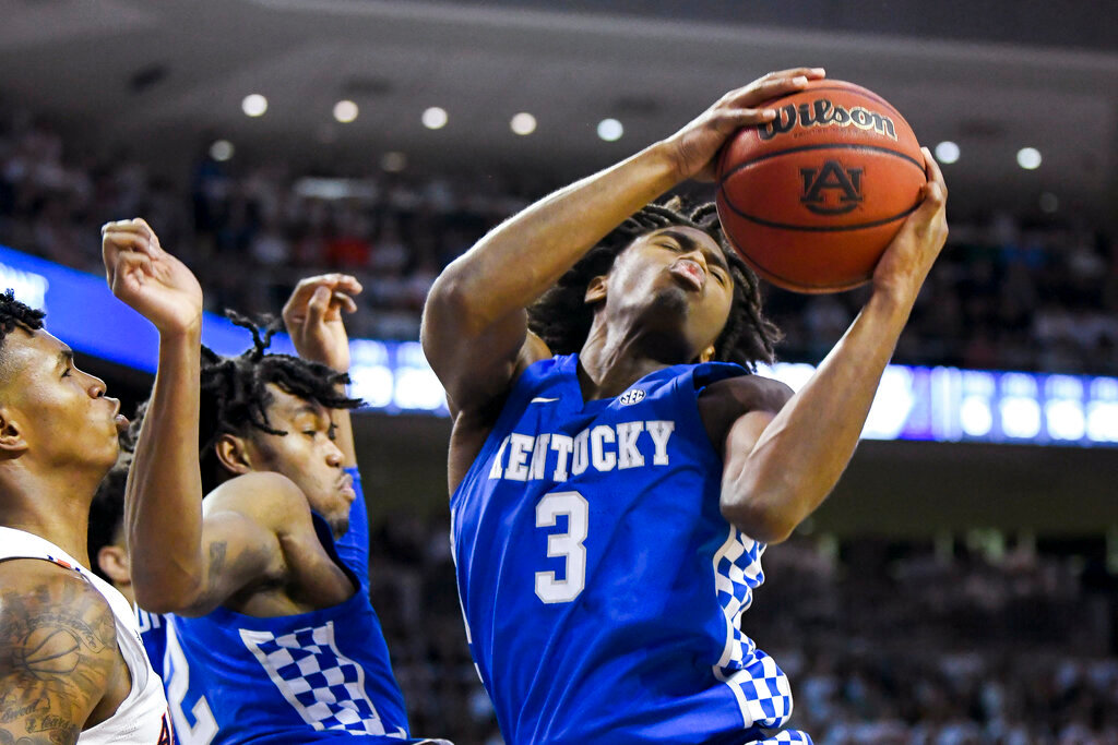 Kentucky guard Tyrese Maxey (3) snags a rebound from Auburn during the second half of an NCAA college basketball game Saturday, Feb. 1, 2020, in Auburn, Ala. (AP Photo/Julie Bennett)