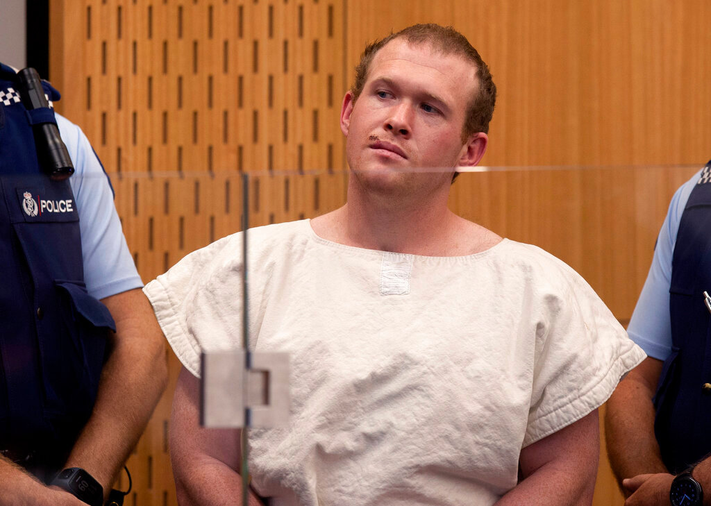 In this Saturday, March 16, 2019, file photo, Brenton Tarrant, the man charged in relation to the Christchurch mosque shootings, appears in the Christchurch District Court, in Christchurch, New Zealand. One year after killing 51 worshipers at two Christchurch mosques, Tarrant, an Australian white supremacist accused of the slaughter on Thursday, March 26, 2020, changed his plea to guilty. (Mark Mitchell/Pool Photo via AP, File)