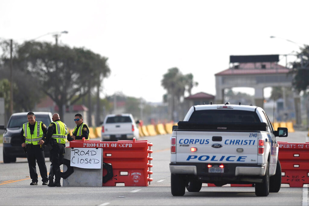 "The entrances to the Naval Air Station-Corpus Christi are closed following an active shooter threat, Thursday, May 21, 2020, in Corpus Christi, Texas. Naval Air Station-Corpus Christi says the shooter was ""neutralized"" and the facility is on lockdown. Annie Rice/Corpus Christi Caller-Times via AP)."