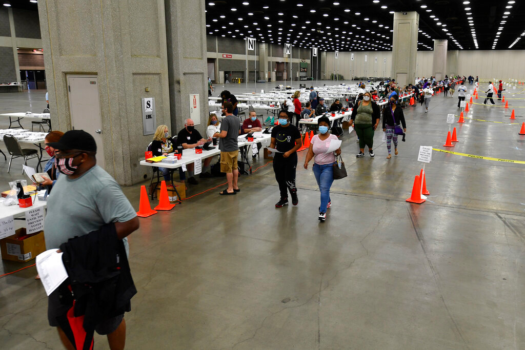Voters head to the designated area to fill out their ballots in the kentucky primary at the Kentucky Exposition Center in Louisville, Ky., Tuesday, June 23, 2020. In an attempt to prevent the spread of the coronavirus, neighborhood precincts were closed and voters that didn't cast mail in ballots were directed to one central polling location.  (AP Photo/Timothy D. Easley)