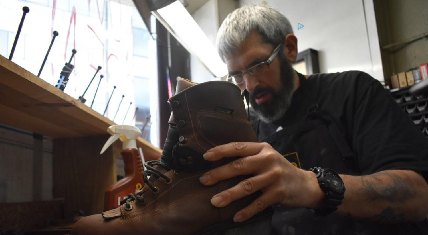 Jimmy Garland, one of the new owners of the Boaz Shoe Repair in Paducah, works on a boot. (Paducah Sun/Derek Operle)