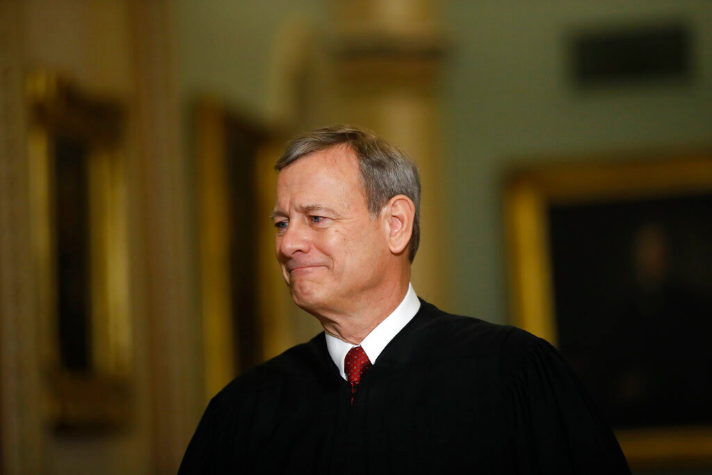 Chief Justice of the United States, John Roberts walks to the Senate chamber at the Capitol in Washington, Thursday, Jan. 16, 2020. (AP Photo/Matt Rourke)