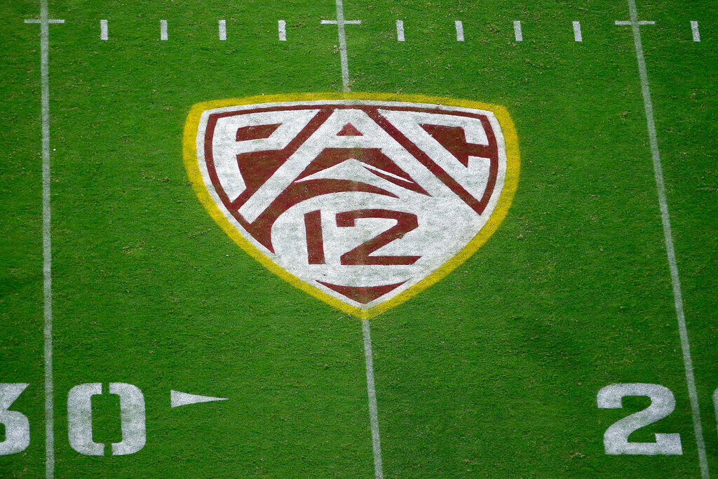 This Aug. 29, 2019, file photo shows the Pac-12 logo at Sun Devil Stadium during the second half of an NCAA college football game between Arizona State and Kent State in Tempe, Ariz. The Pac-12 has become the second major conference to shift to a conference-only fall schedule amid growing concerns over the coronavirus pandemic. (AP Photo/Ralph Freso, File)