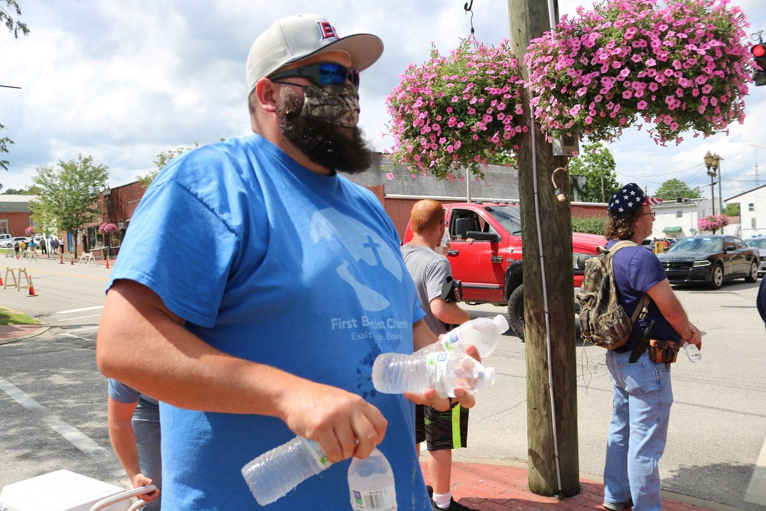 Cory Jones, the youth pastor at First Baptist Church in Grayson, hands out some cold water during a Black Lives Matter protest march in the small Kentucky town. (Tim Preston/Carter County Post)