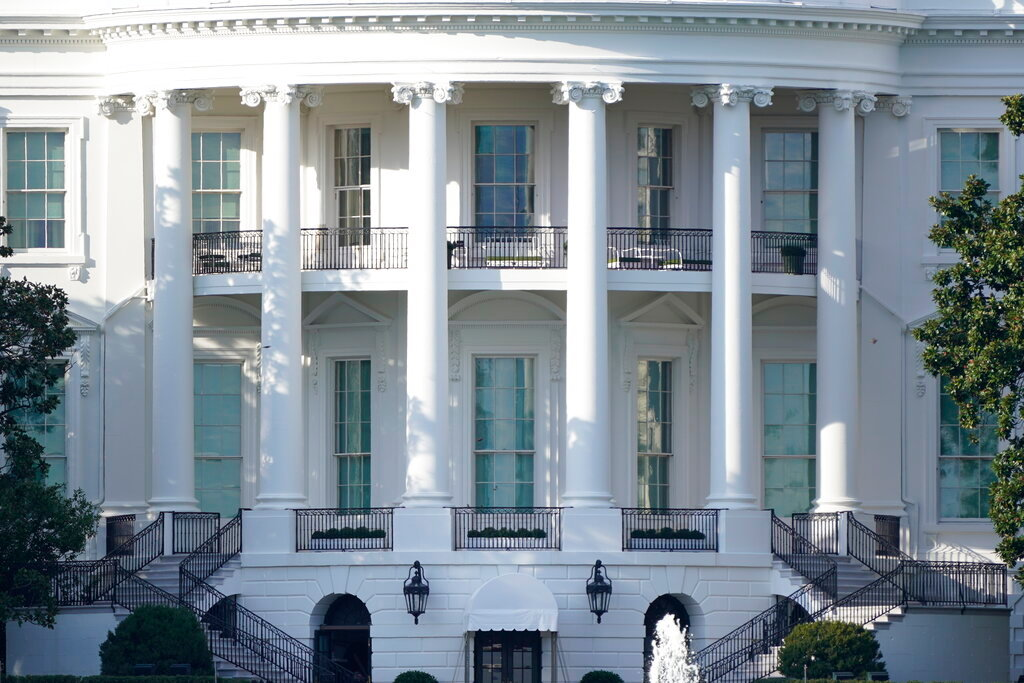 In this Oct. 5, 2020 file photo, the White House is shown Monday afternoon, Oct. 5, 2020, in Washington. hat the race for the White House is decided not at the ballot box but in court. (AP Photo/J. Scott Applewhite)