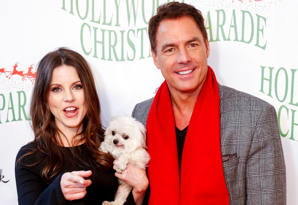 Leanza Cornett, left, and Mark Steines arrive at the 85th Annual Hollywood Christmas Parade on Sunday, Nov. 27, 2016, in Los Angeles. (Photo by Willy Sanjuan/Invision/AP)