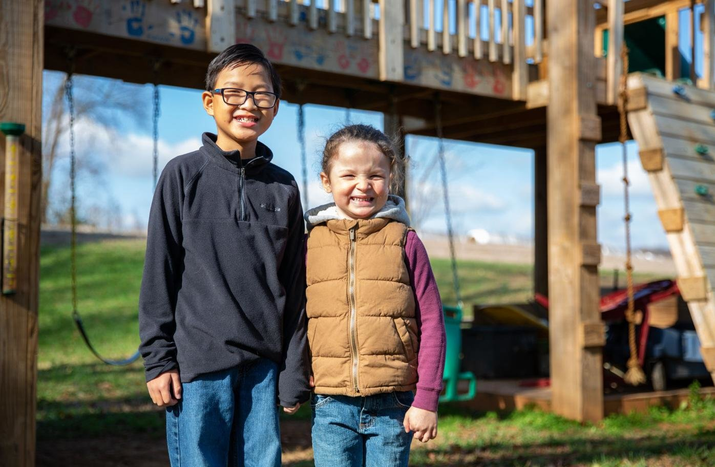 Tag Poynter (right), 6, and his brother Trey ,9, play Monday on the swing set they have in their back yard, Nov. 23, 2020. Josh and Monica Poynter adopted Trey in January 2020 after finding out that he has the same rare bleeding disorder Tag was born with, hemophilia A.