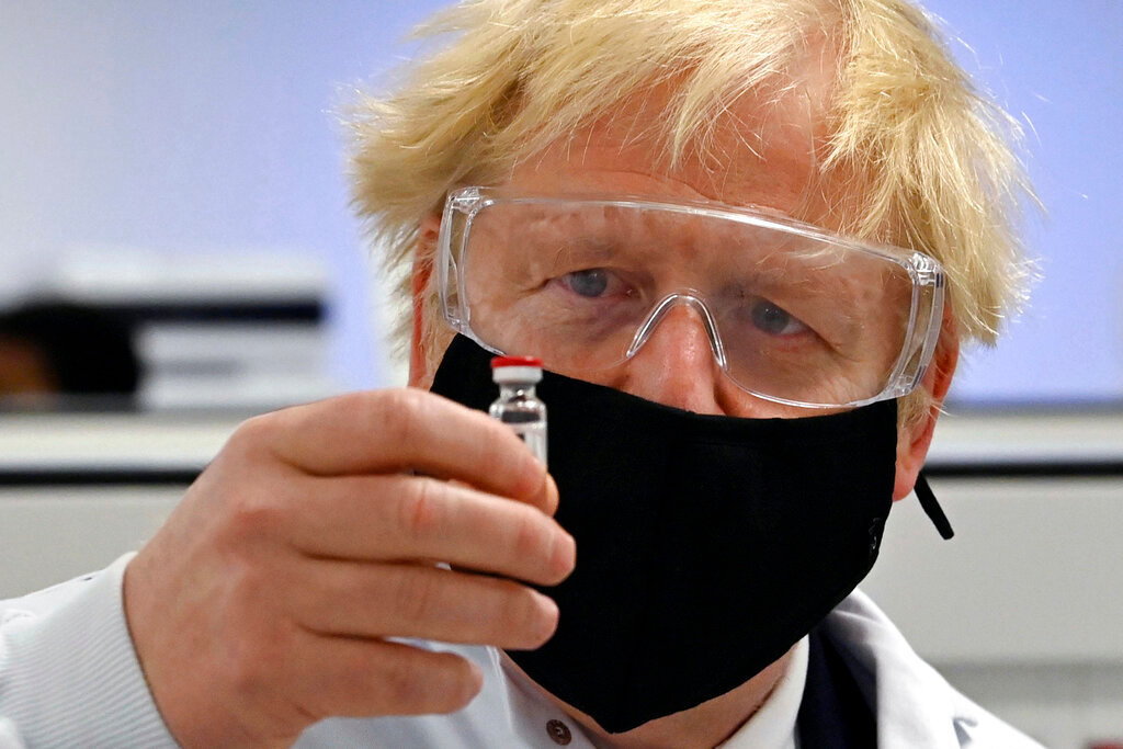Prime Minister Boris Johnson holds a vial of the Oxford/AstraZeneca vaccine Covid-19 candidate vaccine, known as AZD1222. (Paul Ellis/PA Wire)
