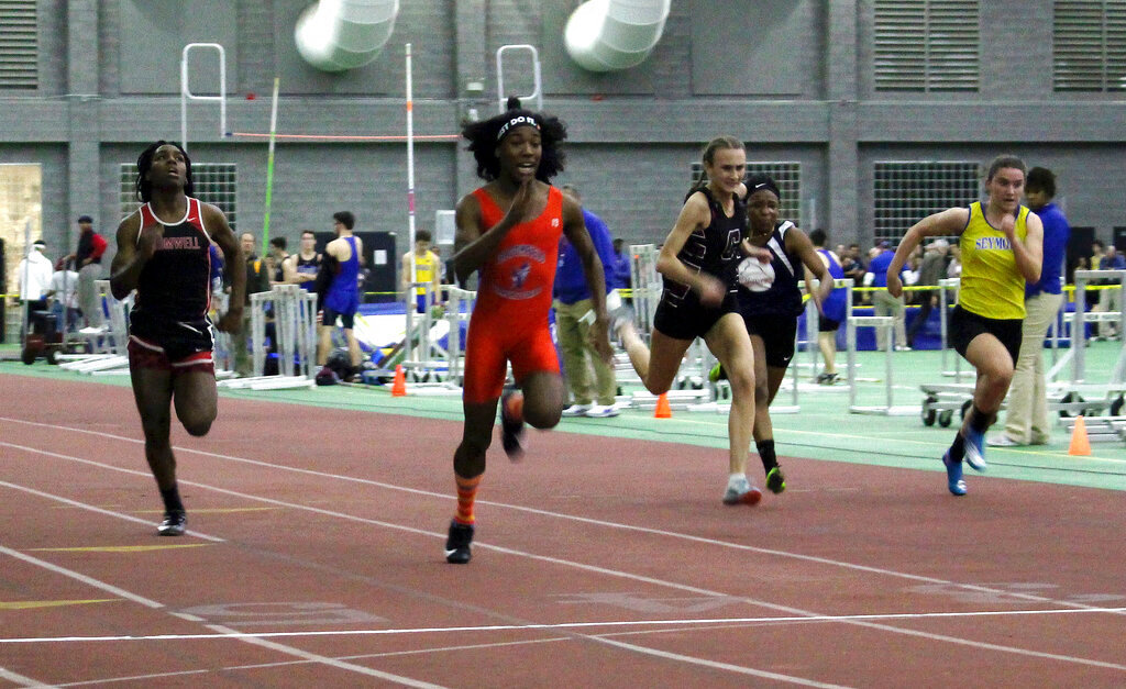 In this Feb. 7, 2019 file photo, Bloomfield High School transgender athlete Terry Miller, second from left, wins the final of the 55-meter dash over transgender athlete Andraya Yearwood, far left, and other runners in the Connecticut girls Class S indoor track meet at Hillhouse High School in New Haven, Conn. The federal Office for Civil Rights has launched an investigation into Connecticut's policy allowing transgender high school athletes to compete as the gender with which they identify. (AP Photo/Pat Eaton-Robb, File)