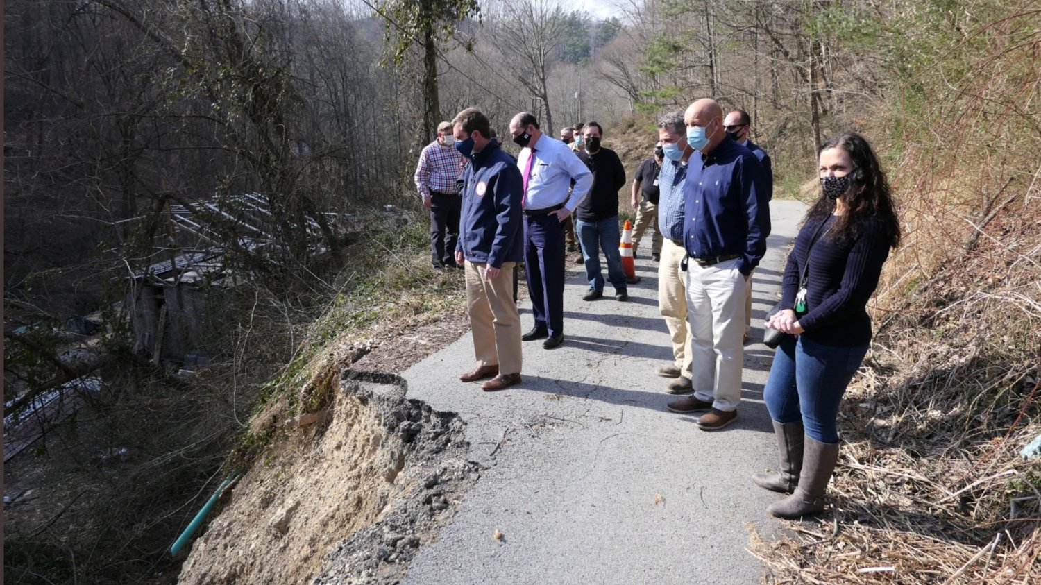 Gov. Andy Beshear and Senior Advisor Rocky Adkins tour flood damage in Perry County last month after severe flooding. Beshear is asking President Biden for a major disaster declaration. (Governor's Office photo)