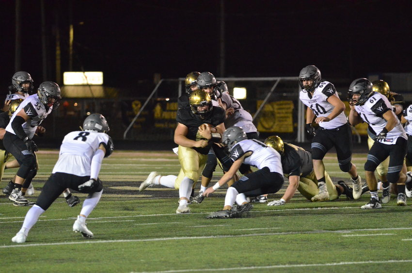 Lebanon senior Drew McBride rushes the ball during Friday's game against the Willard Tigers. LHS won the game, 47-14.