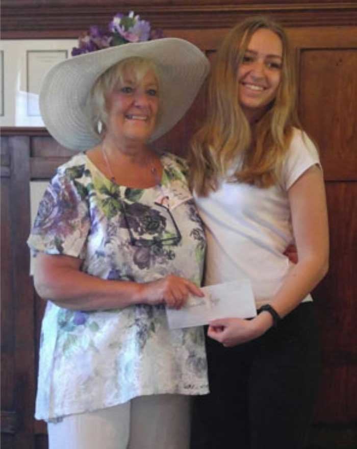 President of Friends of Connetquot Ginny Fields (left) presents the $500 scholarship to Samantha Jaggi (right).