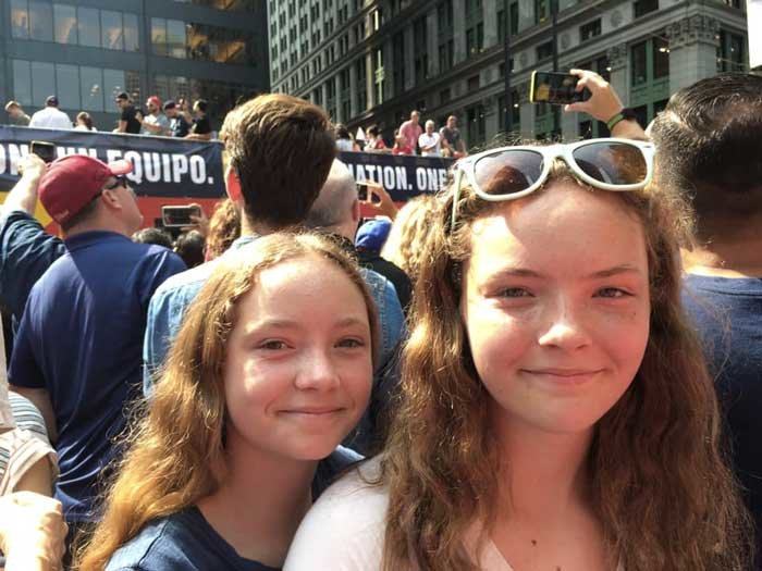 The Bertsch girls of Sayville enjoy the parade: Audrey, 12, and Sophia, 14.