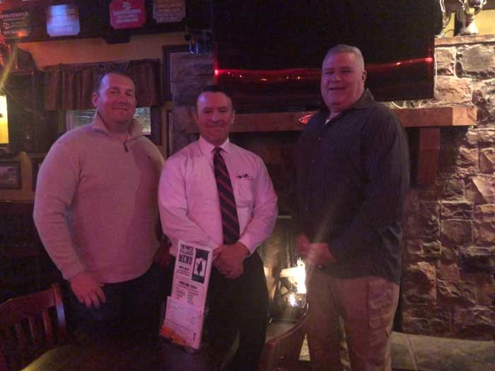 Pictured are event organizers Rob Blair, James Bertsch and Chris Bailey at the Portly Villager, 261 West Main Street in Sayville. For tickets or sponsorships, visit https://www.bigtenherogame.com.