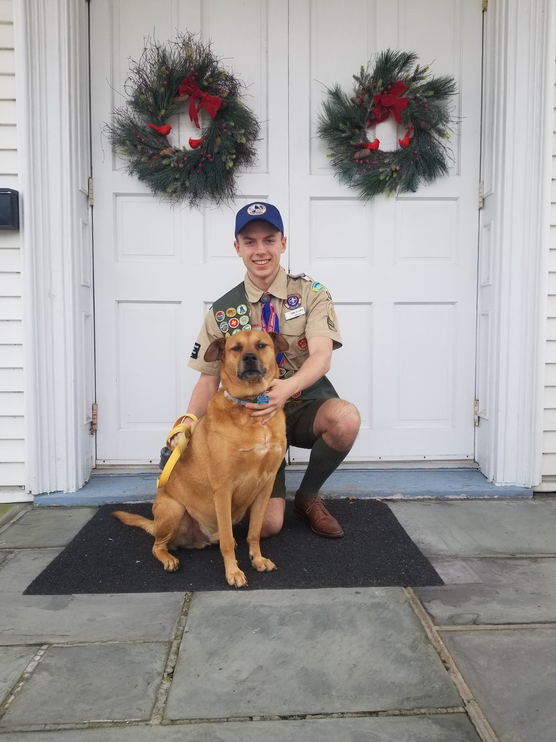 Raising $2,500, Frank, pictured here with his dog, Rocky, and family members worked tirelessly to renovate the common room of the Bayport Methodist Church as his Eagle Scout project.