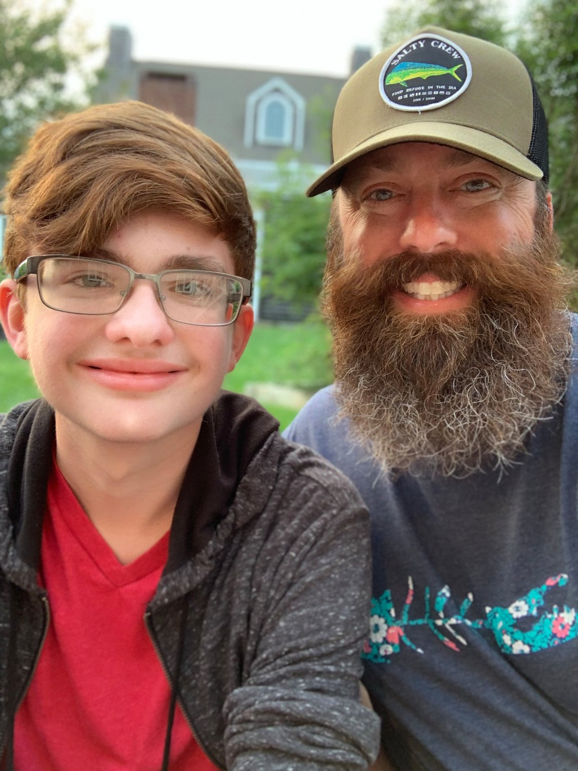 Still able to take fun selfies despite being an in-demand photographer, Ryan is pictured here with his supportive father, Craig.