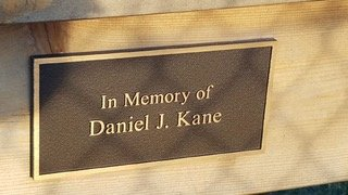 One of the two benches installed around the memorial is dedicated to Daniel J. Kane.