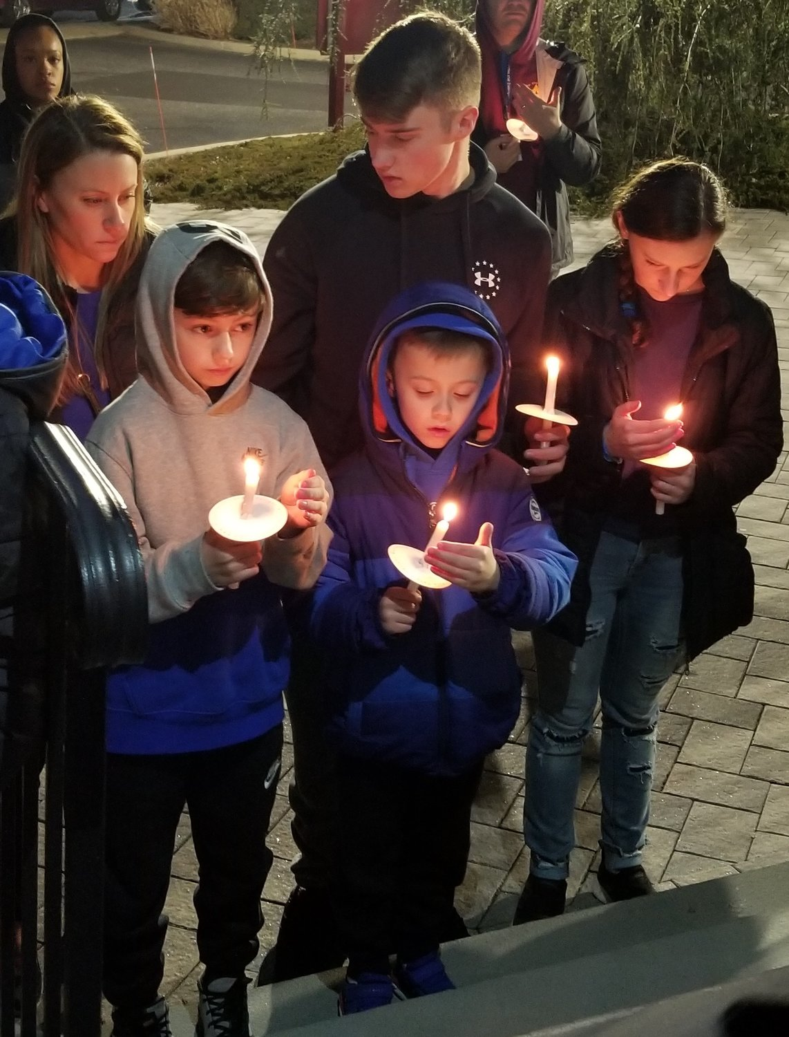 The Munsch family came out to support justice for Thomas Valva as many other families with young children attended the vigil held for Thomas at St. John's church.
