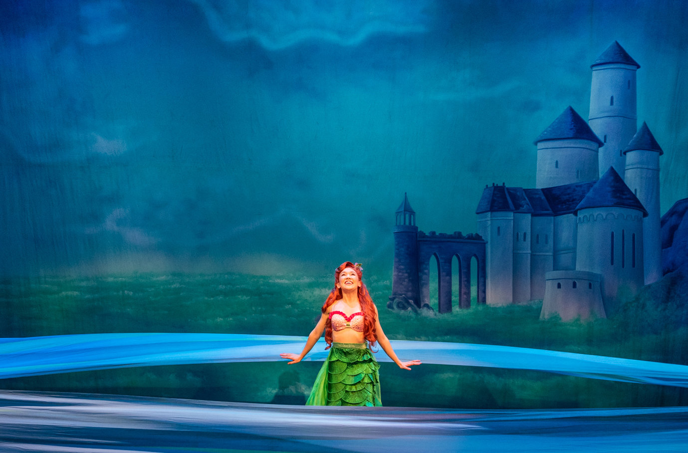 Kimberly Immanuel as Ariel sings her hauntingly beautiful songs, attracting the debonair Prince Eric as she longs to live in the world above.