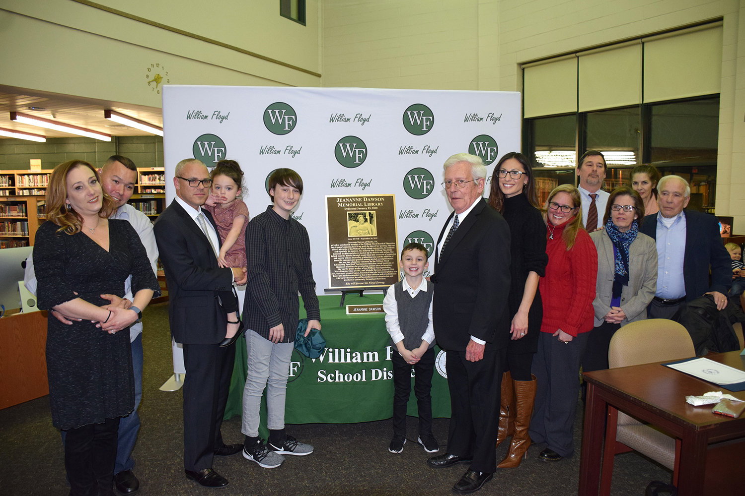 The Dawson family celebrates the renaming and dedication of the William Floyd High School library to the Jeananne Dawson Memorial Library.