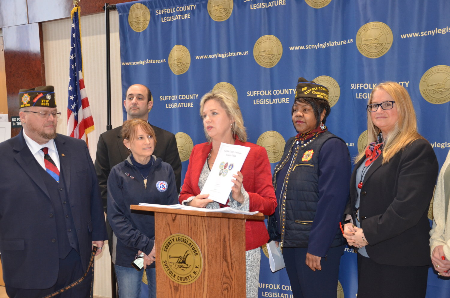 """We have an obligation to ensure that our veterans have quick and reliable access to the services on a moment's notice, and that is what this resource guide accomplishes,"" said Legis. Sarah Anker (center), whose legislation enabled the guide's creation."