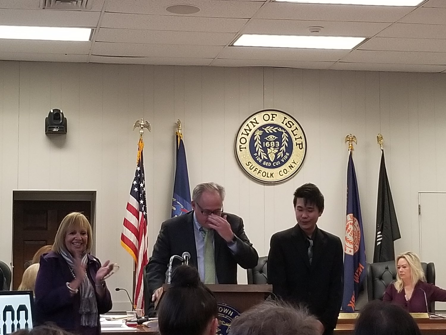 Yu Kevin Zhu is honored for his achievements as the first semifinalist in the Regeneron Science Talent Search from Central Islip High School.