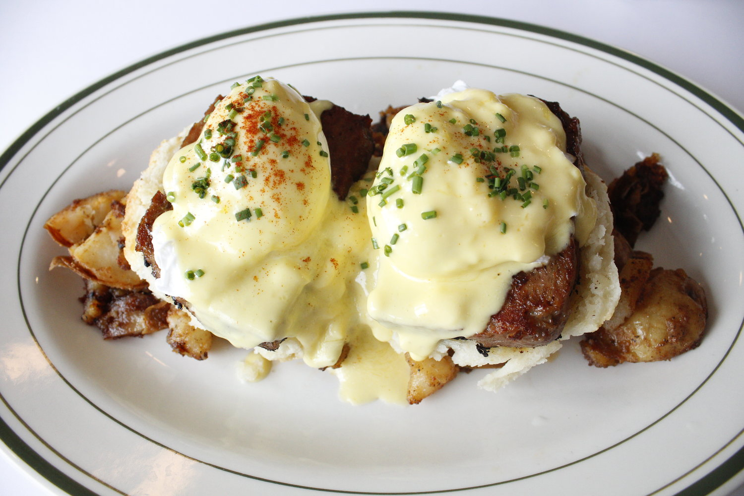 For a hefty meal, go for the eggs benedict, this version served with maple sausage and a biscuit.