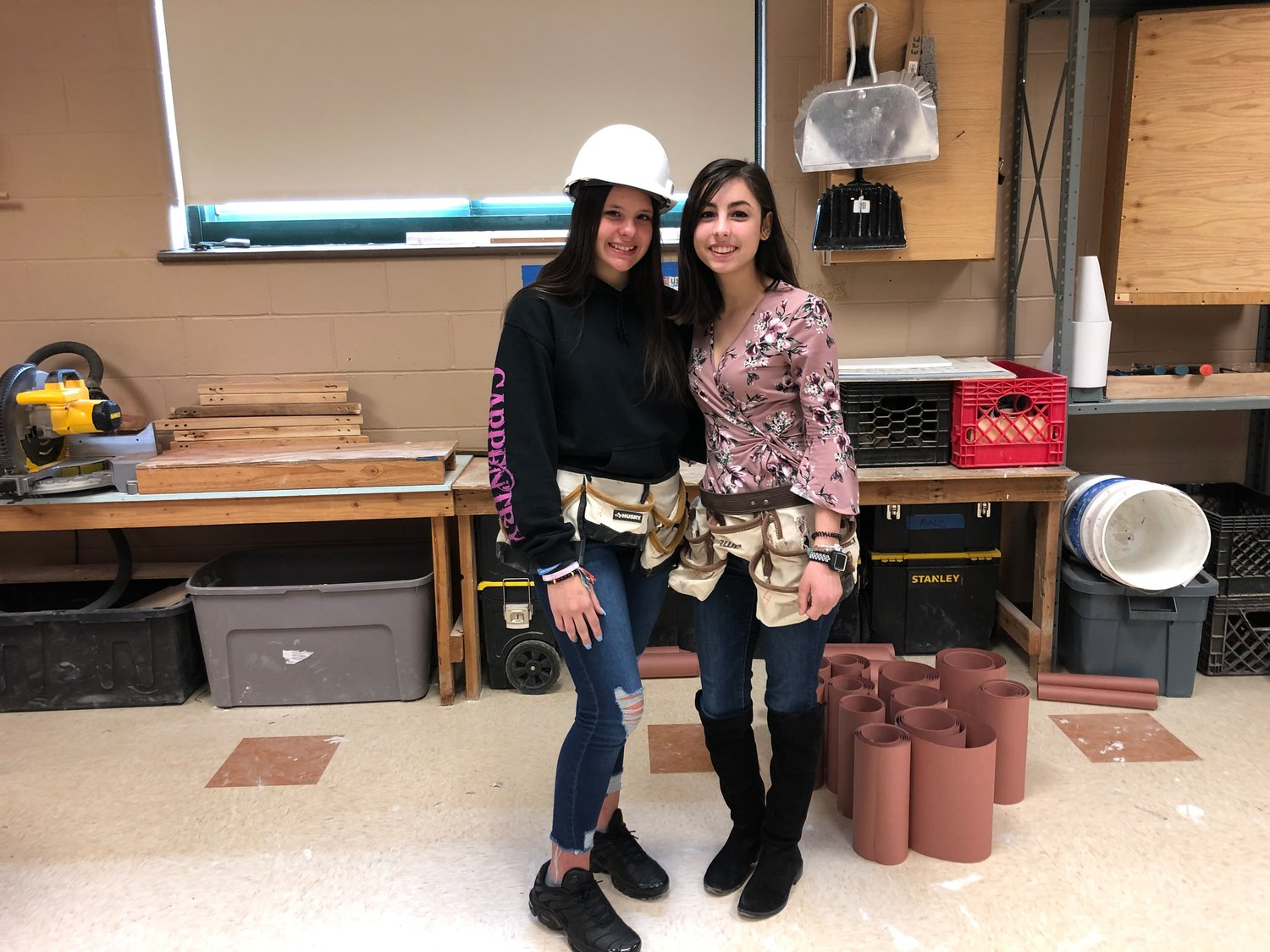 Juniors Lauren Chavez (left) and Giovanna Capitello (right) are two females among 30 males enrolled in this year's carpentry program.