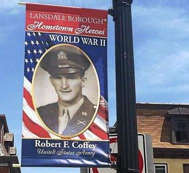 The Hometown Heroes 2020 Banner Program will introduce East Islip to banners of local service men and women on Main Street for two weeks in June-July. Pictured is a banner hung in Pennsylvania of a World War II veteran and generally serves as an example of what to expect.
