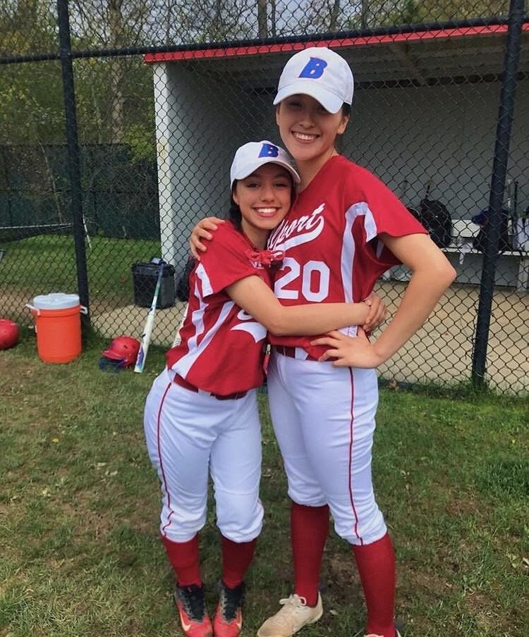 Graduating seniors and softball team players Kat Vignona (left) and Valerie Fabian (right).