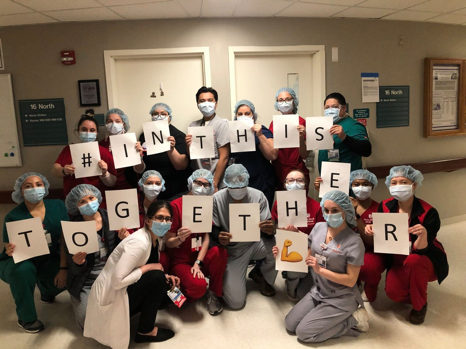 Nurses at Stony Brook University Hospital participate in the #InThisTogether campaign, showing support for fellow nurses and health care workers.