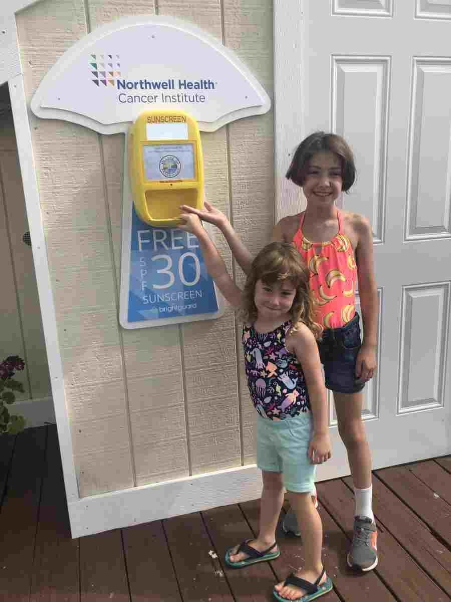 Pictured are Patchogue Village trustee Joe Keyes' granddaughters Charlotte and Juliet at the pool's sunblock dispenser last year.