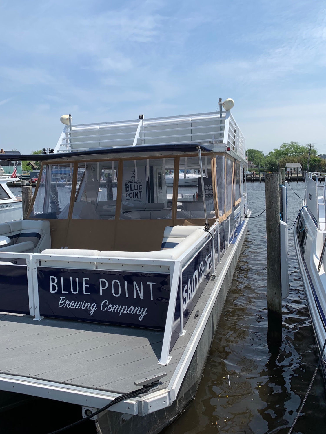 The Salty Bastard is a 45-foot pontoon, one of Blue Point Brewery's newest purchases with plans to sail the Great South Bay this summer and fall.