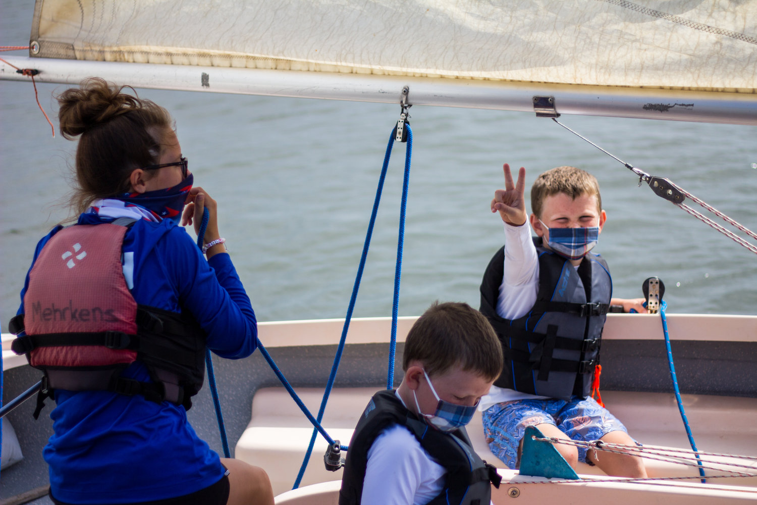 Instructors and sailors take to the seas in masks, ready for lessons this summer.
