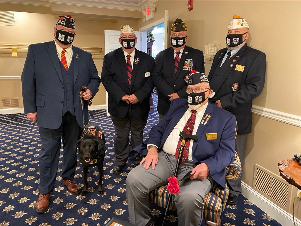 The local VFW Post 2913 celebrates being awarded an All-American post for the second time in a row. Pictured are members Dave Rogers and his service dog, Grunt, George Barrett, Scott McKendrick, Jeff Molitor, and George Egan in a mask, serving their community despite the pandemic.