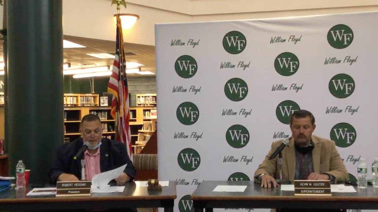 Board of education president Bob Vecchio and superintendent of schools Kevin Coster, along with other administrators, discuss William Floyd's plans to reopen this fall in a meeting on Tuesday.