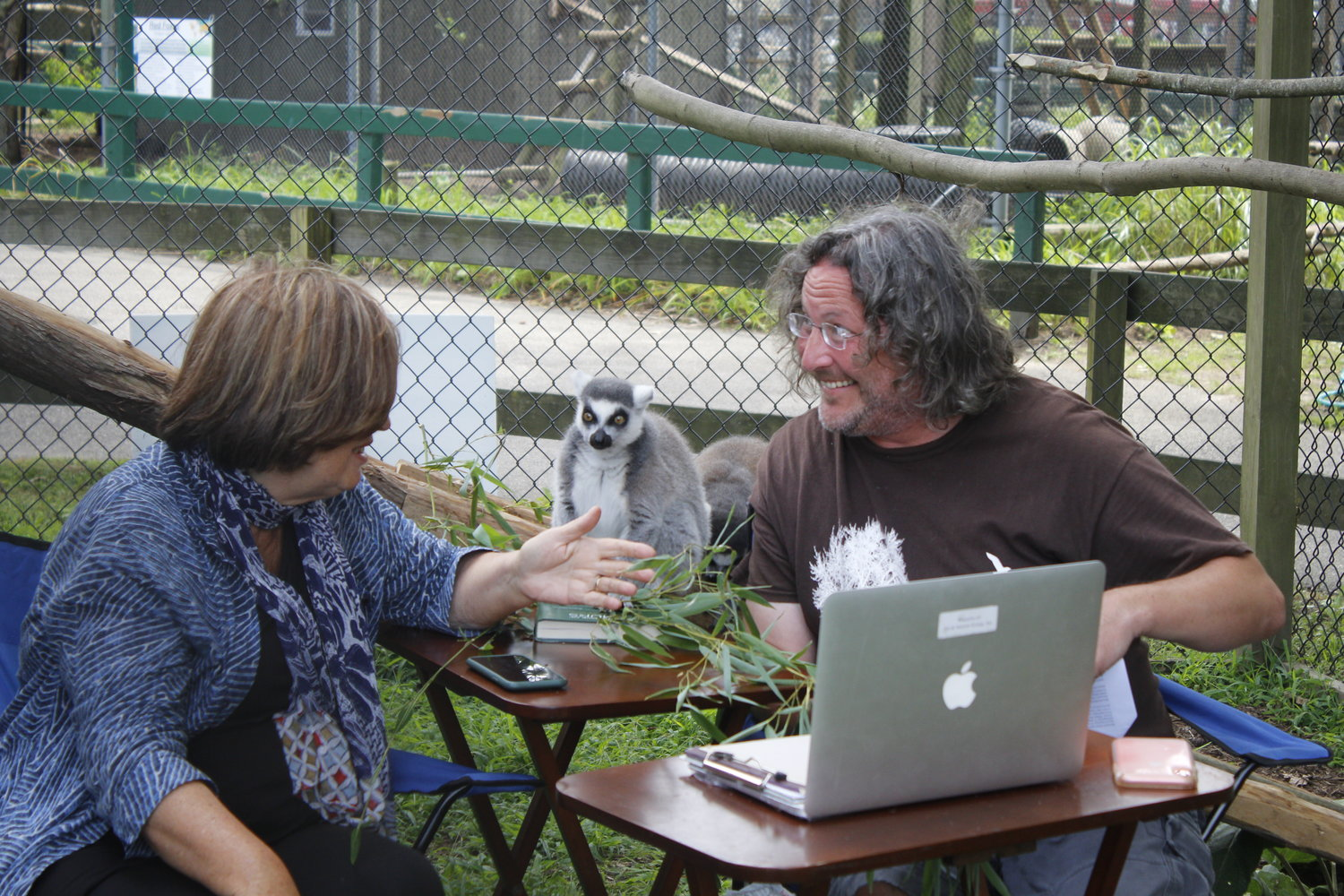 Dr. Patricia Wright, one of the world's most recognized lemur experts, chats with Ranger Eric Powers of CEED inside the Long Island Game Farm lemur enclosure.