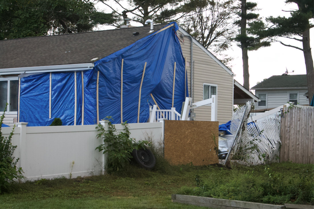 The damage caused by the incident could be seen Tuesday morning on Blue Jay Drive in Brentwood, just two days after an intoxicated Bay Shore woman drove a vehicle into a house with her children in the car.