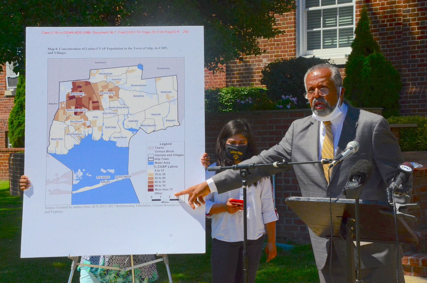 Hempstead civil rights attorney Frederick Brewington discusses the case at a press conference in front of Islip Town Hall Friday, July 31, one day after Hon. Gary Brown ordered the Town of Islip to federal court regarding the case.