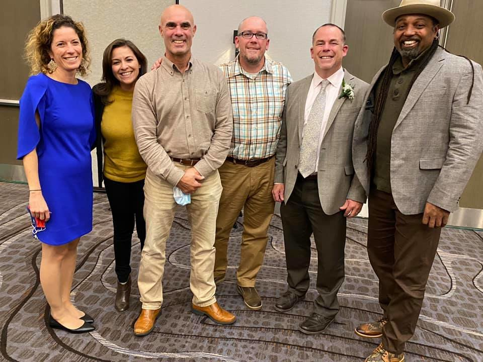 LICSS 2020 Outstanding teacher of the Year Andrew Budris (second from right) is pictured with South Country Central School District social studies faculty (from left to right) Megan Bevan, Wendy Palladino, Paul Feltman, Dennis Pluth and Wayne White.