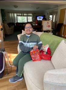 A Brookside Multicare Nursing Center resident smiles with the gifts he received from last year's Adopt-a-Child event.