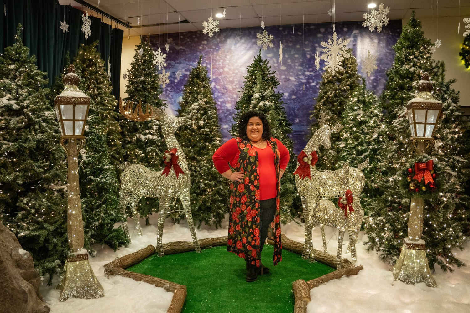 CMPAC executive director Alyse Arpino stands in the middle of a perfect Instagram shot within the Enchanted Reindeer Forest.