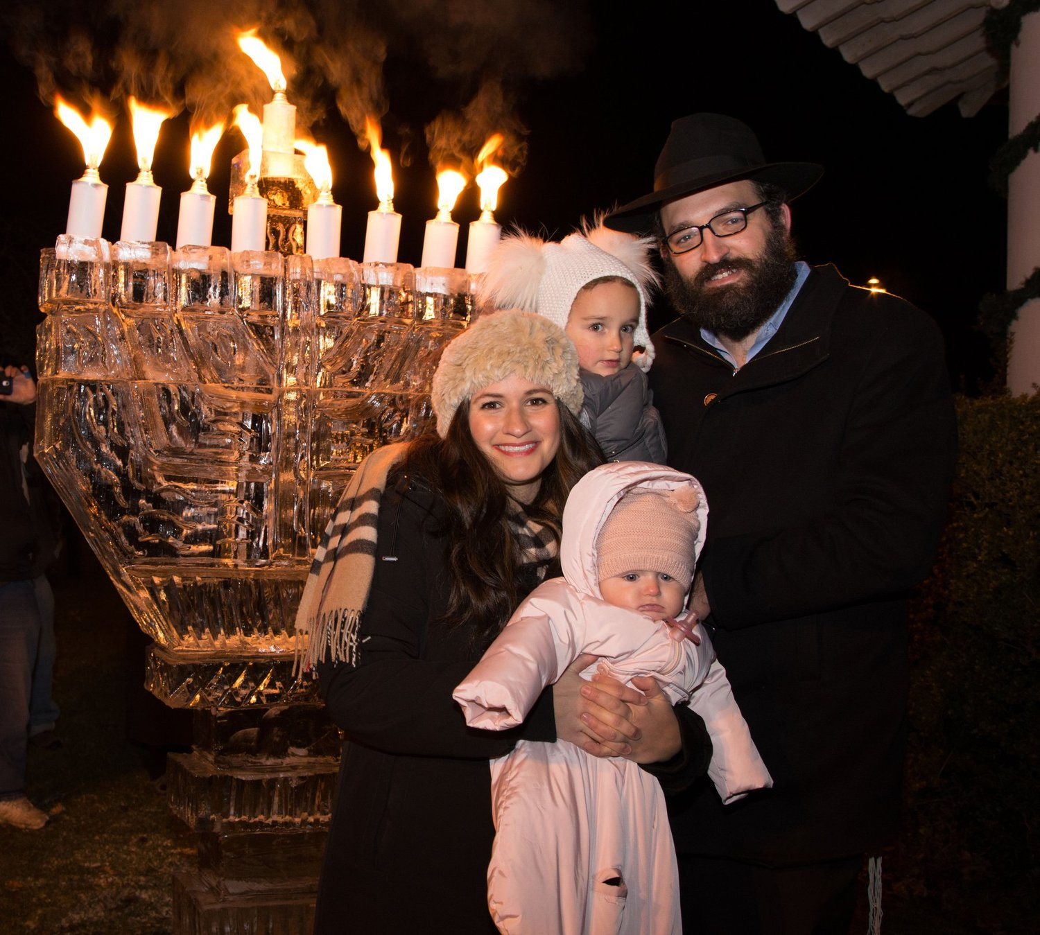 Rabbi Shimon Stillerman and wife, Zeldy, in 2018 at Chabad of Islip's annual Hanukkah event on Main Street in Brightwaters Village.